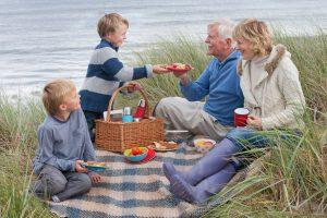 Grandparents having a picnic with grandchldren