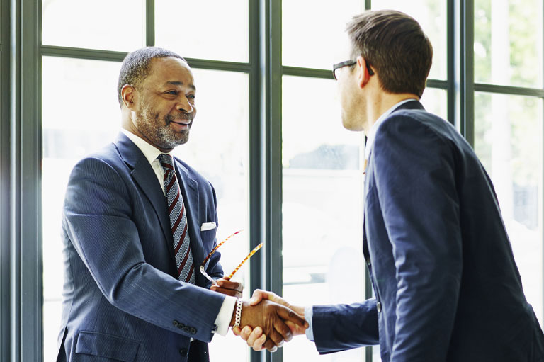 Private Client Banking - relationships are key - two men shaking hands