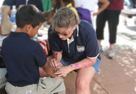 Sheryl Face Painting on a little kid's arm